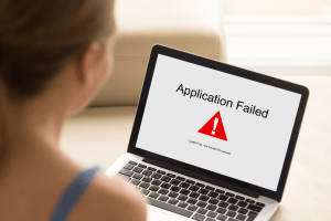 laptop showing failed application message illustrating importance of testing