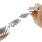 hands shuffling cards in the air illustrating the scrambling of data for testing
